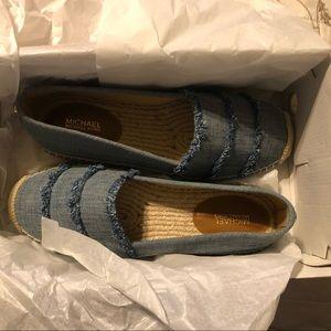 Sz 8 micheal Kors slip on washed denim shoes.